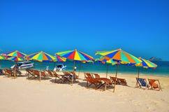 Sea,Island,umbrella,Thailand, Khai Island Phuket, Sun beds and sun umbrellas on a tropical beach. Sea,Island,umbrella,Thailand, Khai Island Phuket, Sun beds and Royalty Free Stock Photo