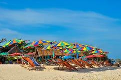 Sea,Island,umbrella,Thailand, Khai Island Phuket, Sun beds and sun umbrellas on a tropical beach. Sea,Island,umbrella,Thailand, Khai Island Phuket, Sun beds and Royalty Free Stock Image