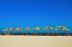 Sea,Island,umbrella,Thailand, Khai Island Phuket, Sun beds and sun umbrellas on a tropical beach. Sea,Island,umbrella,Thailand, Khai Island Phuket, Sun beds and Stock Photography