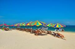 Sea,Island,umbrella,Thailand, Khai Island Phuket, Sun beds and sun umbrellas on a tropical beach. Sea,Island,umbrella,Thailand, Khai Island Phuket, Sun beds and Royalty Free Stock Images