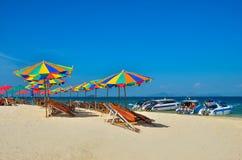 Sea,Island,umbrella,Thailand, Khai Island Phuket, Sun beds and sun umbrellas on a tropical beach. Sea,Island,umbrella,Thailand, Khai Island Phuket, Sun beds and Royalty Free Stock Photos