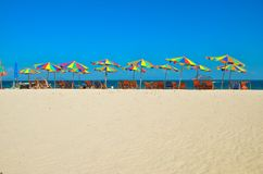 Sea,Island,umbrella,Thailand, Thai Island Phuket Sun beds and sun umbrellas on a tropical beac. Sea,Island,umbrella,Thailand , Khai Island Phuket, Sun beds and Royalty Free Stock Photos