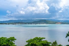 Sea and island view in Samui island, Thailand. Sea and island viewpoint from Wat Phra Yai Great Buddha temple under cloudy blue sky in summer season in Samui royalty free stock images