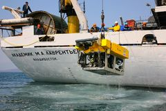 Sea of Japan / Russia - April 2010: Remotely operated underwater. Vehicle ROV lifting on board of Russian carrier vessel after the working in abyssworking in stock photos