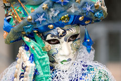 The sea jewel. A venetian woman wearing a mask with waves and net over the costume Stock Photography