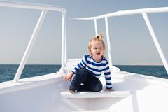 Sea journey. Baby boy enjoy vacation on cruise ship. Child cute sailor yacht sunny day. Boy adorable sailor striped Stock Photo
