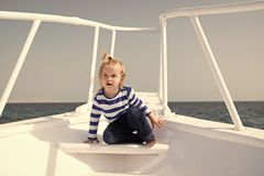 Sea journey. Baby boy enjoy vacation on cruise ship. Child cute sailor yacht sunny day. Boy adorable sailor striped. Shirt white yacht travel around world royalty free stock images