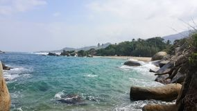Sea, jungle and beach. View of a beach, jungle and ocean in Tayrona National Park, North Colombia Stock Photos