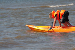 Sea kayak. A child (boy) at sea in a kayak stock photography
