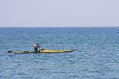 Sea kayak. Yellow sea kayak being paddled across a Great Lake Stock Photo