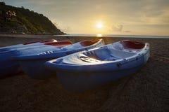Sea kayak on sea beach against beautiful sun rising sky Royalty Free Stock Photography