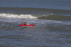 Sea Kayak and Breaking Waves Stock Photography