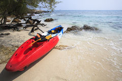Sea kayak canoe on sea sand beach with beautiful nature coast be Royalty Free Stock Images