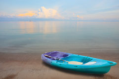 Sea kayak on sand beach Stock Images