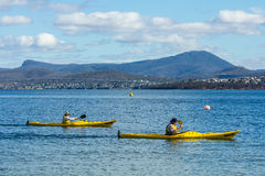 Sea kayakers paddling near Hobart, Tasmania, Australia Stock Photo