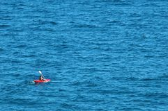 Sea kayaking. Man kayaking in a red kayak Stock Photo