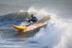 Sea Kayaking. Kayak surfing in heavy winter seas Royalty Free Stock Photography