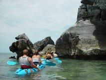 Sea Kayaking. Line of Sea Kayaks around rocky islands offf the thai coast near Ao Nang Royalty Free Stock Photo