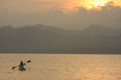 Sea kayaking at sunrise Stock Image