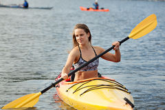 Sea kayaking. Young woman enjoying her sea kayaking adventure stock images