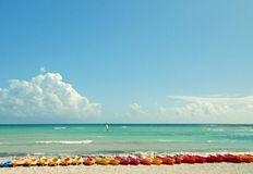 Sea Kayaks. In a row on the beach in Mexico Stock Photo