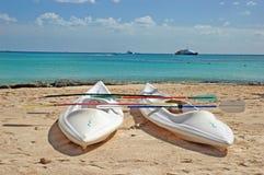 Sea kayaks closeup. A closeup shot of two sea kayaks awaiting use on a sandy beach Stock Photos