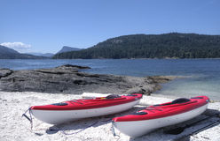 Sea kayaks on an isolated west coast beach Stock Photos