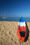 Sea Kayaks in sunlight. Colorful ocean sea kayaks ready to go Stock Photography