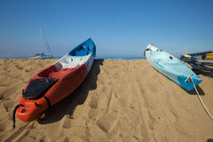 Sea Kayaks in sunlight. Colorful ocean sea kayaks ready to go Royalty Free Stock Image