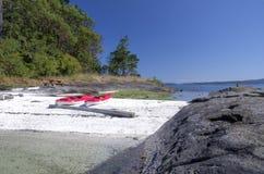 Sea kayaks on an  west coast beach. Sea kayaks, Gulf Islands National Park reserve, Canada Stock Photo