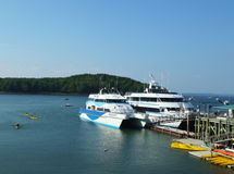 Sea kayaks and whale watching boats ready for tourists in Bar Harbor, Maine Royalty Free Stock Photos