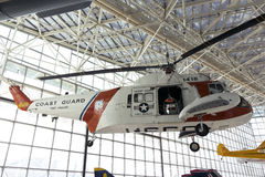 Sea king coast guard helicopter. SEATTLE, WA - JANUARY 12, 2012: a sea king coast guard helicopter is hung from the ceiling inside a glass structure at the Stock Photography