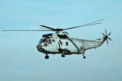 Sea King XV 707. Side view of Sea King XV 707 military helicopter in flight with blue sky background Royalty Free Stock Image