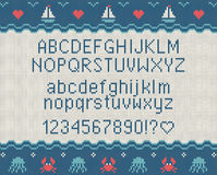 Sea knitted font. Knitted latin alphabet on sea theme patterns background. Woolen knitted texture. Nordic Fair Isle sweater design Stock Images
