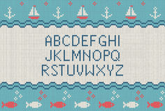 Sea knitted font. Knitted latin alphabet on sea theme patterns background. Woolen knitted texture. Nordic Fair Isle sweater design Stock Photo