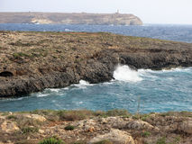 Sea of the LAMPEDUSA island in Italy. Island of Lampedusa in Italy with Cliff and blue sea stock images