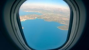 The sea and the land are shown from the porthole. HD stock video footage