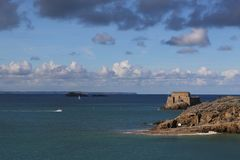 Sea landsape with white motorboat near Saint-Malo stock photography