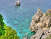 Sea landscape. Landscape- rocks, green, blue, water Royalty Free Stock Photography