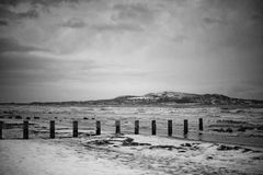 Sea landscape. Landscape in bay of Dublin, black and white with snow Stock Photography