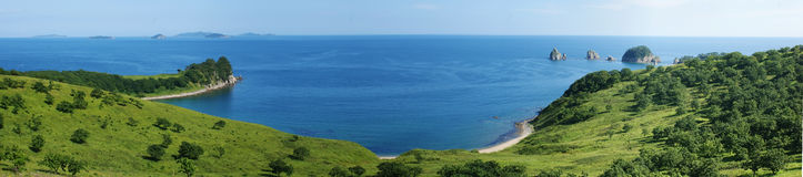 Sea landscape. A panorama of the beautiful sea landscape with green banks Stock Photo