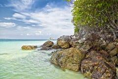 Sea landscape. Sea, stone, beach and blue sky Stock Image