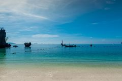 sea landscape in blue colors - traditional Thai boats Royalty Free Stock Image
