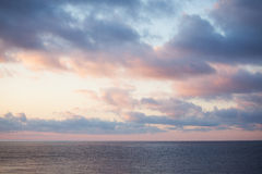 Sea landscape with a cloudy sky in