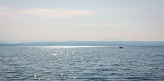 Sea landscape with a fishing boat on a sunny summer day royalty free stock image