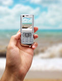 Sea landscape into mobile screen royalty free stock photo