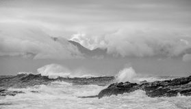 Sea landscape. An morning, Clouds sky and mountains. Black and white photo Stock Images