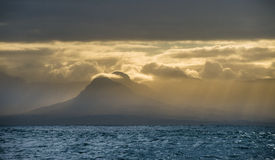 Sea landscape. An morning, Clouds sky and mountains. Royalty Free Stock Photography