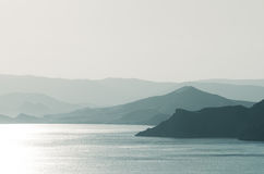 Sea landscape with mountains and sunshine Royalty Free Stock Photo