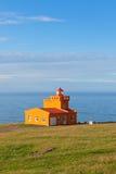 Sea Landscape with Orange Lighthouse and Blue Sky Stock Photos